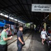 The slowing train stops several meters away at Maeklong Station